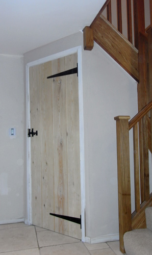 Carpenters witney oxfordshire uk carpentry england for Door under stairs
